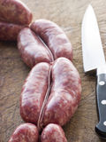 Tuscan sausage in Links. Tuscan sausages in Links with knife stock image