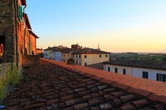 Tuscan sunset on the roofs stock photo