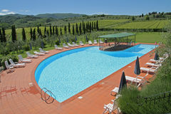 Peaceful swimming pool in the Tuscan countryside of Italy Royalty Free Stock Photo