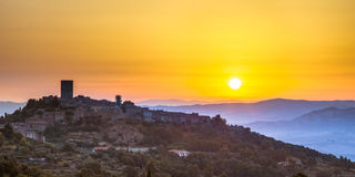 Tuscan Town at Sunrise. Sunrise over Tuscan Town of Montecatini in Val di Cecina near Volterra, Italy royalty free stock photography