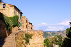 Tuscan view. Stone houses of Pienza overlooking the countryside of Tuscany Royalty Free Stock Photos