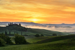 Tuscan villa at dawn. A beautiful tuscan landscape and villa at dawn Stock Image
