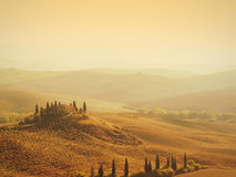 Tuscan villa sunrise. Sunrise over a famous farmer's villa near San Quirico d'Orcia and Pienza in the val dorcia in Tuscany, Italy Stock Photo