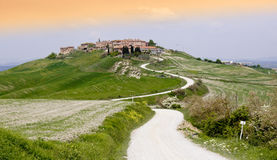 Tuscan Village. In the Siena region called crete Senesi, typical hilly scenary, Tuscany, Italy stock image