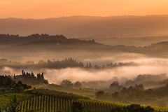 Tuscan Village Landscape on a Foggy Morning Stock Photo