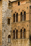 Tuscan Walls and Windows. A detail of an Italian wall in San Gimignano, Italy, featuring a wide and rich pallet of earth tones and strong design lines Royalty Free Stock Photos