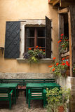 Tuscan windows. Tuscan window in an old house with flowers Stock Images