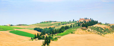 Tuscany. A country house located among sprawling hills in Tuscany stock image