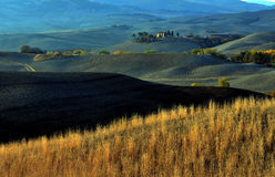 Tuscany. Small house in the middle of Tuscany hills Royalty Free Stock Photo