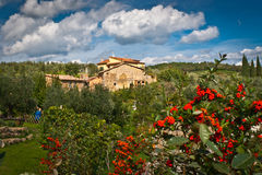 Tuscany. Landscape with tuscany architecture and garden in foreground Stock Photos