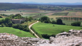 Tuscany Agriturismo Italy. Medium long high angle high dynamic range shallow depth of field tracking slider shot moving over the ledge of the town walls of stock video footage