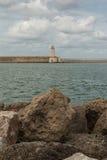 Tuscany Coastline: White Lighthouse Tower, Cliffs and Stone Jetty near Sea, Italy royalty free stock photos