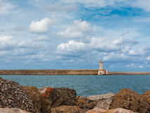 Tuscany Coastline: White Lighthouse Tower, Cliffs and Stone Jetty near Sea, Italy stock photos