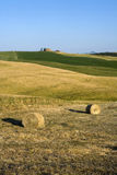 TUSCANY countryside with farms and hay-ball. Tuscan countryside with hay-balls and distant farms Stock Photo