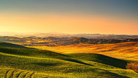 Tuscany countryside misty panorama, rolling hills and green fiel Royalty Free Stock Images