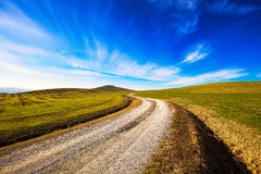 Tuscany countryside, road, fieldd and meadow and rolling hills. Stock Photo