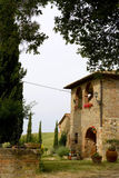 TUSCANY courtyard with cypress and farm Stock Photography