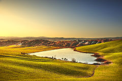 Tuscany, Crete Senesi rural landscape on sunset, Italy. Lake and Stock Photography
