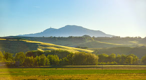 Tuscany, evening sun. Summer green hills rise Stock Photo
