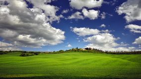 Tuscany famous cypress trees with green fields and farmers home stock image