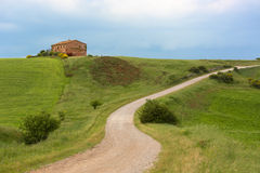 Tuscany farmhouse with lightning at horizon, Pienza, Italy Royalty Free Stock Photos
