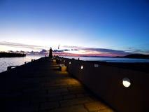Italy, Tuscany, Grosseto, Maremma, Cactiglione della Pescaia, view of the pier and port at sunset Stock Photos