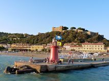 Italy, Tuscany, Grosseto, Maremma, Cactiglione della Pescaia, View of the port and the castle by the sea. Tuscany, Grosseto, Maremma, Cactiglione della Pescaia royalty free stock photos