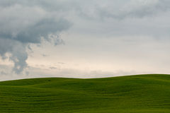 Tuscany hill in Val d'Orcia on a cloudy day. Tuscany hill in Val d'Orcia, Pienza on a cloudy day royalty free stock images