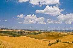 Tuscany hills. With blue sky and white clouds Royalty Free Stock Photos