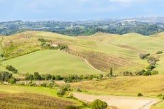 Tuscany - hills and farmhouse Royalty Free Stock Photography