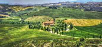 Tuscan cottage hills  painting-like landscape road Royalty Free Stock Photo