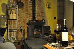Tuscany home fireside and wine Royalty Free Stock Photos