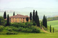 Tuscany house in fog Stock Photography