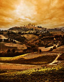 Tuscany, Italy. Dramatic Sunset Tuscany landscape: San Gimignano on the background Royalty Free Stock Image