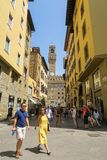Yellow buildings and famous palazzo vecchio in the background, w stock image