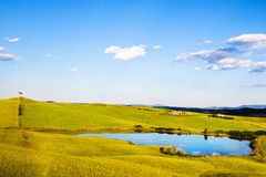 Tuscany, lake, tree and green fields, rural landscape on sunset, Royalty Free Stock Photo