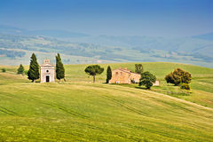 Tuscany landscape with chapel on hill, Val dOrcia, Stock Image