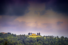 Tuscany landscape with dark storm clouds Stock Photos