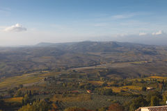 Tuscany landscape in the early morning fog, Italy. Royalty Free Stock Photography