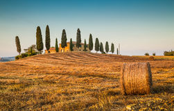 Tuscany landscape with farm house at sunset, Val d'Orcia, Italy Stock Photography