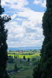 Tuscany landscape framed by two huge cypress trees, near San Gimignano Royalty Free Stock Photos
