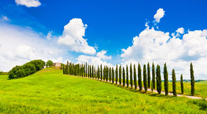 Tuscany landscape with house on a hill. Scenic Tuscany landscape with typical farm house on a hill in Val d'Orcia, Italy Royalty Free Stock Photo
