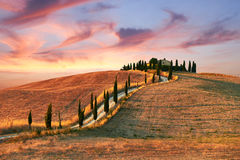 Tuscany Landscape. With italian house on the top hill and clouds stock photography
