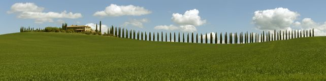 Tuscany panorama with farmhouse and cypresses Royalty Free Stock Photography