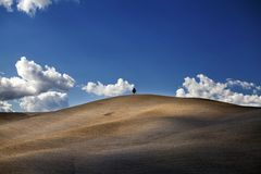 Tuscany - Landscape panorama, hills and meadow Royalty Free Stock Photo