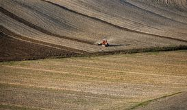 Tuscany - Landscape panorama, hills and meadow. Tractor on a field in Tuscany area of Italy during autumn Royalty Free Stock Photos