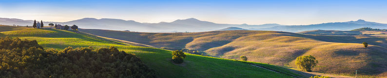 Tuscany landscape panorama at sunrise with a chapel of Madonna d. I Vitaleta, San Quirico d'Orcia, Italy. Vintage Stock Photos