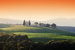 Tuscany landscape at sunrise with a little chapel of Madonna di Vitaleta, Italy. Stock Photos