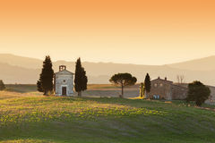 Tuscany landscape at sunrise with a little chapel of Madonna di Vitaleta, Italy. Royalty Free Stock Image