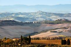 Tuscany landscape at sunrise. Tuscan farm house, vineyard, hills. Royalty Free Stock Photography